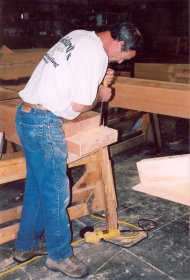 man hand-crafting a beam